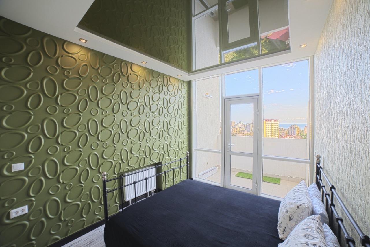 Спальная с балконом