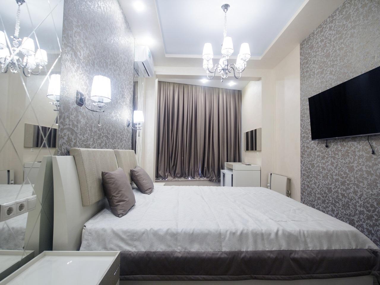 Спальная с телевизором