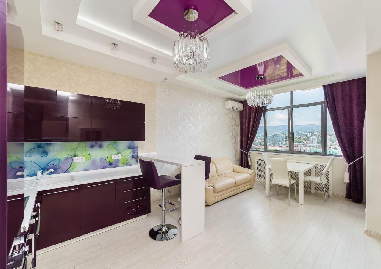 В квартире стильная бордовая кухня